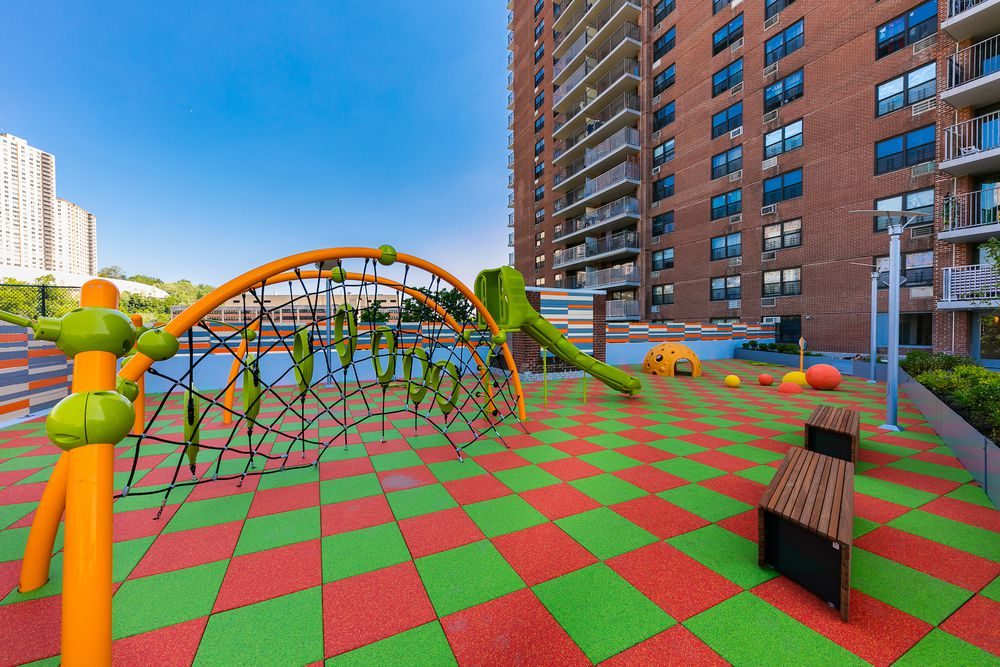 A photo of the outdoor play space at Promenade Apartments