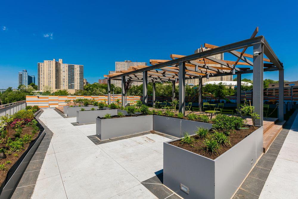 A Pergola in the green space at Promenade Apartments