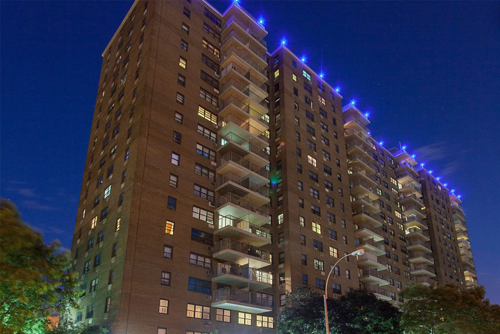 An evening photo of the Hazel Towers in Bronx, NY.
