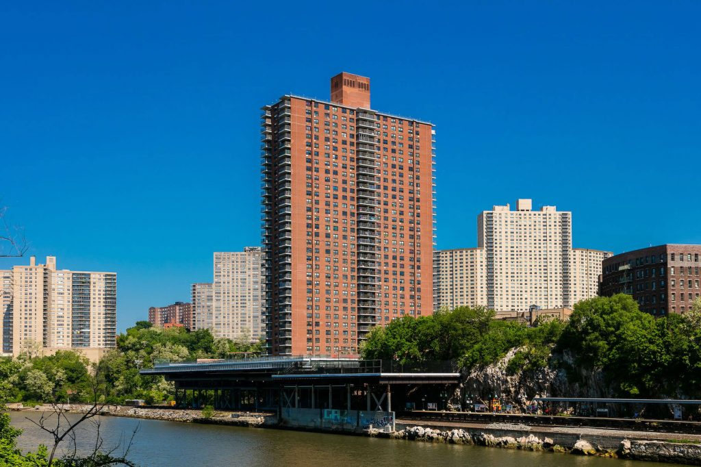 A photo of Promenade apartments building from across the river.