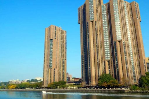 A photo of River Park Towers in Bronx New York as seen from the East River.