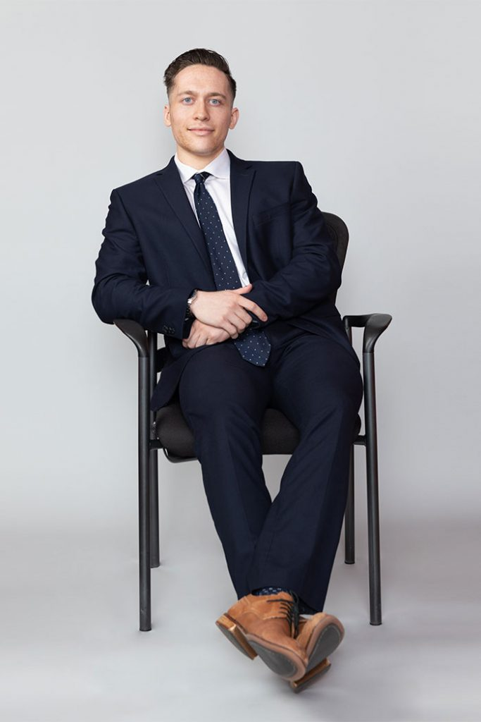 Anthony Bendetti poses in a chair